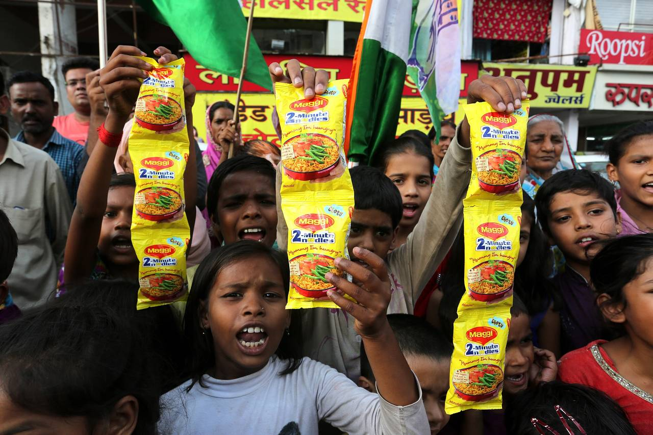 Indian children hold packets of Maggi noodles during a protest in Bhopal, India, on June 5. PHOTO: EUROPEAN PRESSPHOTO AGENCY
